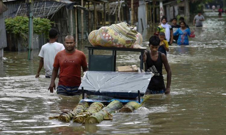 70 Dead As Flood And Landslides Devastate Assam, E