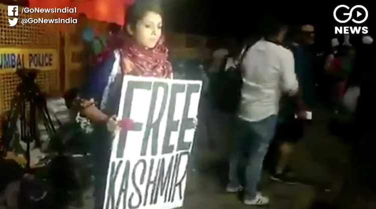 Who is the woman who wave free Kashmir's placard i