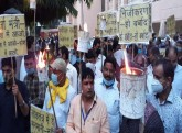 UP: Power Employees Take Out Torch Rally Against P